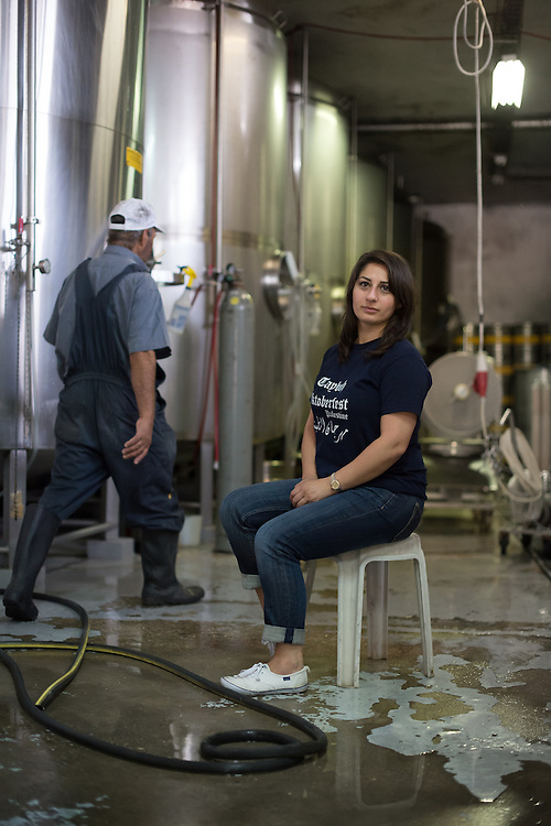 PALESTINE Taybeh, West Bank<br /> <br /> Taybeh Brewery Company:<br /> <br /> Madees Khoury, general manager of the brewery, with one of her workers.