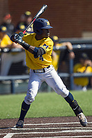 Michigan Wolverines second baseman Ako Thomas (4) at bat against the Illinois Fighting Illini during the NCAA baseball game on April 8, 2017 at Ray Fisher Stadium in Ann Arbor, Michigan. Michigan defeated Illinois 7-0. (Andrew Woolley/Four Seam Images)