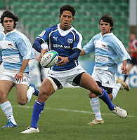 Samoa scrum half Alatasai Tupou preparing to off-load the ball during the 7th place play-off against Argentina at Shaw's Bridge Belfast 2007.