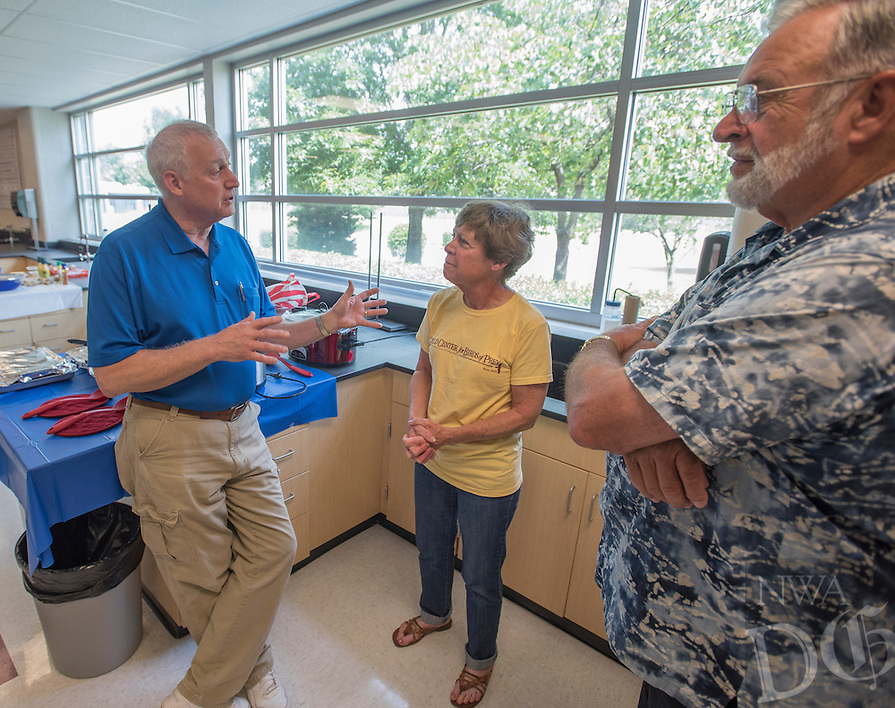 NWA Democrat-Gazette/J.T. WAMPLER Rogers High School teacher Steve Long (from left) visits Thursday May 26, 2016 with Lynn Sciumbato and Bob Ross, both retired teachers. Long is retiring after teaching science (mostly chemistry) for 41 years.