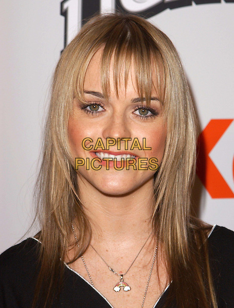 TARYN MANNING.The Cold Mountain L.A. Premiere held at The Mann National Theater in Westwood, California .07 December 2003.portrait, headshot, fringe, hair, necklace.www.capitalpictures.com.sales@capitalpictures.com.©Capital Pictures.