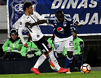 BOGOTA - COLOMBIA – 28 - 02 - 2018: Eliser Quiñones (Izq.) jugador de Millonarios (COL), disputan el balon con Fagner (Der.) jugador de Corinthians (BRA), durante partido entre Millonarios (COL) y Corinthians (BRA), de la fase de grupos, grupo 7, fecha 1 de la Copa Conmebol Libertadores 2018, en el estadio Nemesio Camacho El Campin, de la ciudad de Bogota. / Eliser Quiñones (L) player of Millonarios (COL), fights for the ball with Fagner (R) player of Corinthians (BRA), during a match between Millonarios (COL) and Corinthians (BRA), of the group stage, group 7, 1st date for the Conmebol Copa Libertadores 2018 in the Nemesio Camacho El Campin stadium in Bogota city. VizzorImage / Luis Ramirez / Staff.