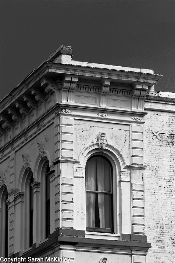 A building with ornate stone work on G Street in Old Town Eureka in Humboldt County in Northern California.