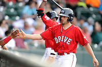 Right fielder Bo Greenwell (31) of the Greenville Drive is congratulated after scoring a run in a game against the Lexington Legends on Sunday, April 27, 2014, at Fluor Field at the West End in Greenville, South Carolina. Greenville won, 21-6. (Tom Priddy/Four Seam Images)