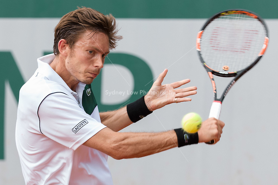 May 24, 2015: Nicolas Mahut (FRA) in action in a 1st round match against Kimmer Coppejans (BEL) on day one of the 2015 French Open tennis tournament at Roland Garros in Paris, France. Mahut won 63 64 76. Sydney Low/AsteriskImages