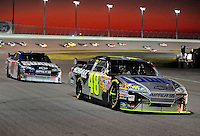 Nov. 16, 2008; Homestead, FL, USA; NASCAR Sprint Cup Series driver Jimmie Johnson (48) leads teammate Dale Earnhardt Jr during the Ford 400 at Homestead Miami Speedway. Mandatory Credit: Mark J. Rebilas-