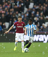 West Ham United's Aaron Cresswell and Huddersfield Town's Aaron Rowe<br /> <br /> Photographer Rob Newell/CameraSport<br /> <br /> The Premier League - West Ham United v Huddersfield Town - Saturday 16th March 2019 - London Stadium - London<br /> <br /> World Copyright © 2019 CameraSport. All rights reserved. 43 Linden Ave. Countesthorpe. Leicester. England. LE8 5PG - Tel: +44 (0) 116 277 4147 - admin@camerasport.com - www.camerasport.com