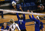 Marymount's Morgan McAlpin and Emileigh Rettig block against St. Mary's during a college volleyball game in Lexington Park, MD, on Wednesday, Oct. 29, 2014. Marymount won 3-2 to go 24-9 on the season.<br /> Photo by Cathleen Allison