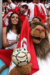 14 June 2006: World Cup mascot Goleo VI (right) poses in front of a Tunesia fan section inside Allianz Arena. Tunisia tied Saudi Arabia 2-2 at the Allianz Arena in Munich, Germany in match 16, a Group H first round game, of the 2006 FIFA World Cup.