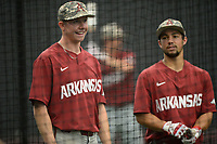 NWA Democrat-Gazette/ANDY SHUPE<br /> Arkansas right fielder Heston Kjerstad (left) and center fielder Dominic Fletcher speak Friday, June 7, 2019, while taking batting practice in The Fowler Family Baseball and Track Training Center ahead of today's NCAA Super Regional game at Baum-Walker Stadium in Fayetteville. Visit nwadg.com/photos to see more photographs from the practices.