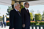 Turkish President Tayyip Erdogan and Palestinian President Mahmoud Abbas review the guards of honour during a welcoming ceremony at the Presidential Palace in Ankara, Turkey, August 28, 2017. Photo by Osama Falah