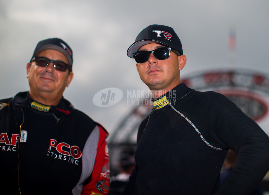 Sept. 1, 2014; Clermont, IN, USA; NHRA top fuel dragster driver Steve Torrence (right) with his father Billy Torrence during the US Nationals at Lucas Oil Raceway. Mandatory Credit: Mark J. Rebilas-USA TODAY Sports