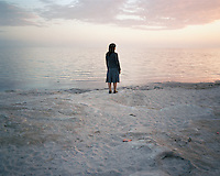 A woman stares out to the Caspian Sea in Aktau.