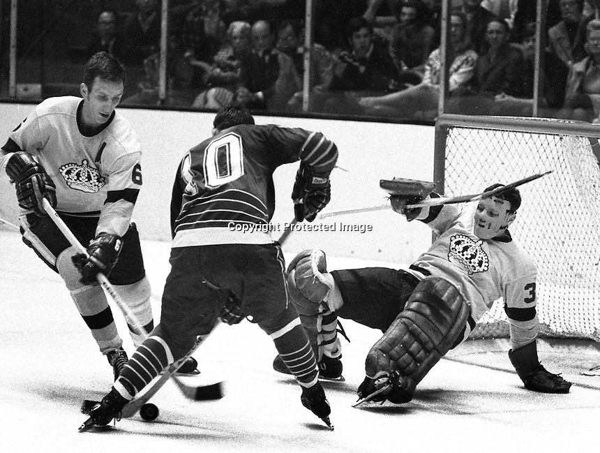 California Golden Seals vs Los Angeles Kings (1969 action) Kings goalie Wajyne Rudledge and #6 Dale Rolfe, Seal #10 Ted Hampson.<br />