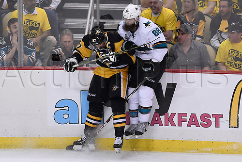 01.06.2016. Pittsburgh, Penn, USA.  Pittsburgh Penguins center Sidney Crosby (87) put a check on San Jose Sharks defenseman Brent Burns (88) along the boards during the third period. The Pittsburgh Penguins won 2-1 in overtime against the San Jose Sharks in Game Two in the 2016 NHL Stanley Cup Final at the Consol Energy Center in Pittsburgh, Pennsylvania.