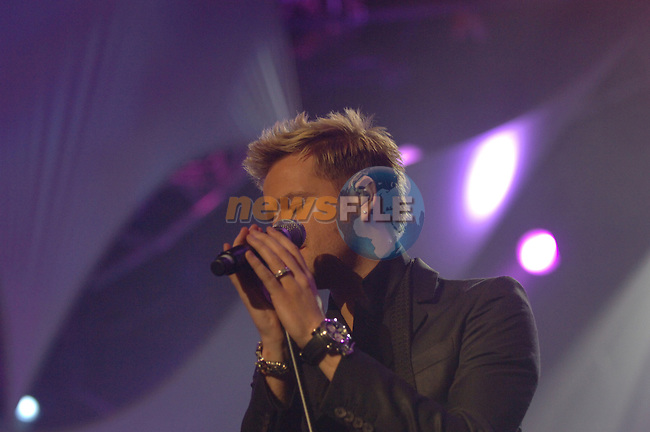 Nicky Byrne of Westlife on stage at the 2007 Childline Concert in the Point Depot in Dublin....Photo NEWSFILE/Colin Bell.(Photo credit should read Colin Bell/NEWSFILE)....This Picture has been sent you under the condtions enclosed by:.Newsfile Ltd..The Studio,.Millmount Abbey,.Drogheda,.Co Meath..Ireland..Tel: +353(0)41-9871240.Fax: +353(0)41-9871260.GSM: +353(0)86-2500958.email: pictures@newsfile.ie.www.newsfile.ie.FTP: 193.120.102.198.