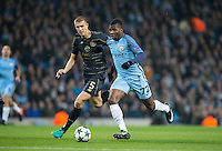 Kelechi Iheanacho of Manchester City on the way to scoring his goal under pressure from Jozo Simunovic of Celtic during the UEFA Champions League GROUP match between Manchester City and Celtic at the Etihad Stadium, Manchester, England on 6 December 2016. Photo by Andy Rowland.