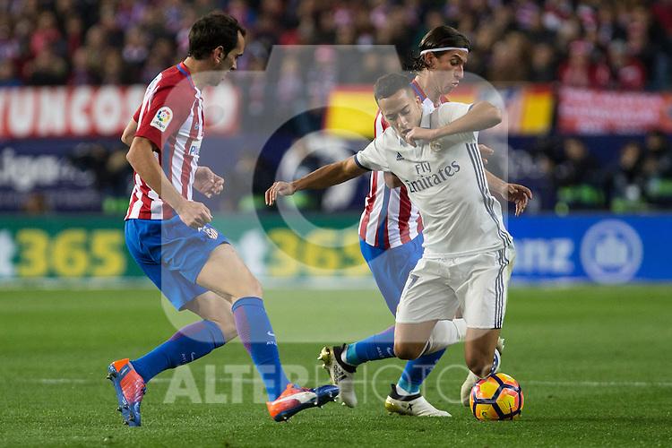 Atletico de Madrid's Diego Godin Real Madrid's Lucas Vazquez during the match of La Liga between Atletico de Madrid and Real Madrid at Vicente Calderon Stadium  in Madrid , Spain. November 19, 2016. (ALTERPHOTOS/Rodrigo Jimenez)