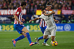 Atletico de Madrid's Diego Godin Real Madrid's Lucas Vazquez during the match of La Liga between Atletico de Madrid and Real Madrid at Vicente Calderon Stadium  in Madrid , Spain. November 19, 2016. (ALTERPHOTOS/Rodrigo Jimenez)