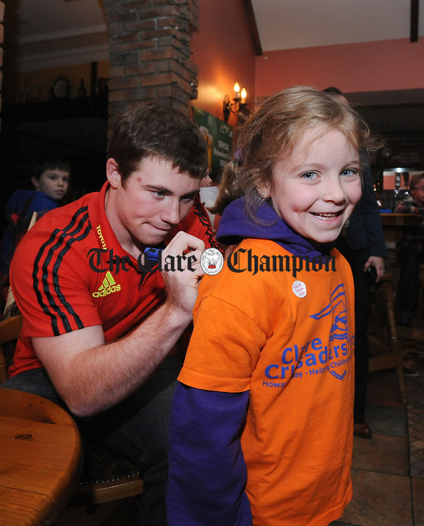 Rachel Mahony from Ennis has her jersey signed by Luke O' Dea during Munster Rugby's visit to the Clare Crusaders in Barefield, one of the rugby club's charities of the year. Photograph by Declan Monaghan