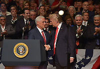 MIAMI, FL - JUNE 16: U.S. President Donald Trump (R) shake hand with U.S. Vice President Mike Pence and speak to a crowd of people and sign an executive order policy changes toward Cuba at the Manuel Artime Theater in the Little Havana neighborhood on June 16, 2017 in Miami, Florida. The President will re-institute some of the restrictions on travel to Cuba and U.S. business dealings with entities tied to the Cuban military and intelligence services. Credit: MPI10 / MediaPunch
