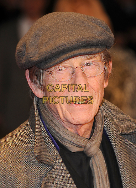 JOHN HURT .European Premiere of 'Brighton Rock' at the Odeon West End, Leicester Square, London, England, UK,.1st February 2011..headshot portrait cap hat glasses grey gray scarf beige .CAP/BEL.©Tom Belcher/Capital Pictures.