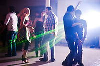 Behind four walls, a few affluent party pockets in Tehran spring up, where people turn a blind eye to what is considered illegal activities by the islamic republic, like wearing too much make up, dancing with members of the opposite sex and drinking alcohol