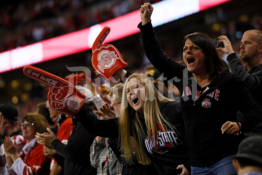 Ohio State Buckeyes fans Heather Bierbaugh, left, and Stacey Richter cheer during the first quarter of the Big Ten championship football game against the Wisconsin Badgers at Lucas Oil Stadium in Indianapolis on Dec. 2, 2017. [Adam Cairns / Dispatch]