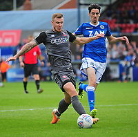 Lincoln City's Michael O'Connor vies for possession with Macclesfield Town's Peter Vincenti<br /> <br /> Photographer Andrew Vaughan/CameraSport<br /> <br /> The EFL Sky Bet League One - Macclesfield Town v Lincoln City - Saturday 15th September 2018 - Moss Rose - Macclesfield<br /> <br /> World Copyright &copy; 2018 CameraSport. All rights reserved. 43 Linden Ave. Countesthorpe. Leicester. England. LE8 5PG - Tel: +44 (0) 116 277 4147 - admin@camerasport.com - www.camerasport.com