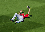 7 September 2014: Washington Nationals outfielder Jayson Werth makes a diving catch against the Philadelphia Phillies at Nationals Park in Washington, DC. The Nationals defeated the Phillies 3-2 to salvage the final game of their 3-game series. Mandatory Credit: Ed Wolfstein Photo *** RAW (NEF) Image File Available ***