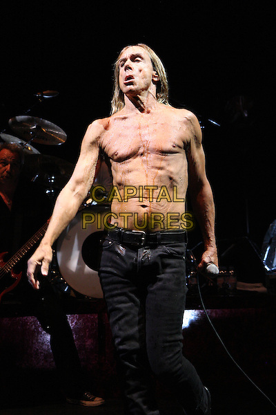 IGGY AND THE STOOGES (Iggy Pop (born James Newell Osterberg)).Performing live at the Hammersmith Apollo, London, England..May 2nd, 2010.stage concert live gig performance music full length black jeans denim chest wrinkled skin full 3/4 funny .CAP/MAR.© Martin Harris/Capital Pictures.