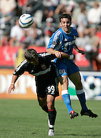 D.C. United's Dema Kovalenko, left and Kansas City Wizards' Kerry Zavagnin, right, battle for a ball during a  3-2 D.C. United victory at the MLS Cup, at the Home Depot Center, in Carson, Calif., Sunday, Oct. 14, 2004.