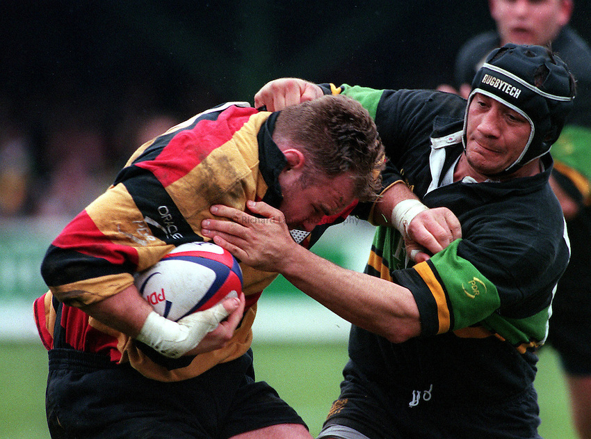 "Photo: Richard Lane.Northampton v Richmond 18.04.98.""Richmonds Scott Quinnell tries to shake the Northampton defence."""