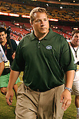 Landover, MD - August 19, 2006 -- New York Jets head coach Eric Mangini leaves the field after his team the beat the  Washington Redskins preseason action at FedEx Field in Landover, Maryland, Saturday, August 19, 2006.  The final score was 27 - 14 in favor of the Jets.<br />