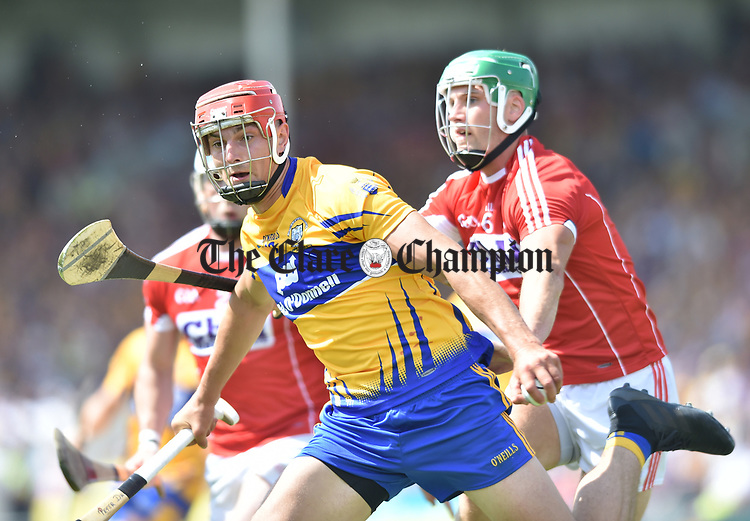 Peter Duggan of Clare in action against Eoin Cadogan of Cork during their Munster senior hurling final at Thurles. Photograph by John Kelly.