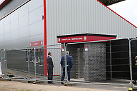 Stevenage Chairman Phil Wallace inspects the new turnstiles at the North West corner of the ground still under construction before Stevenage vs Exeter City, Sky Bet EFL League 2 Football at the Lamex Stadium on 10th August 2019