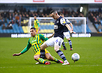 9th February 2020; The Den, London, England; English Championship Football, Millwall versus West Bromwich Albion; Jake Livermore of West Bromwich Albion challenges Shaun Williams of Millwall
