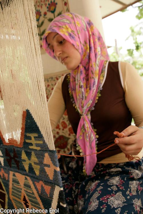 Weaving a woollen kilim, Cappadocia, Turkey.