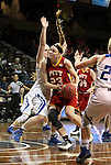 SIOUX FALLS MARCH 22:  Kylie Gafford #23 from Pittsburg State eyes the basket past the defense of Brionna Barnett #23 from Grand Valley State during their quarterfinal game at the NCAA Women's Division II Elite 8 Tournament at the Sanford Pentagon in Sioux Falls, S.D. (Photo by Dave Eggen/Inertia)
