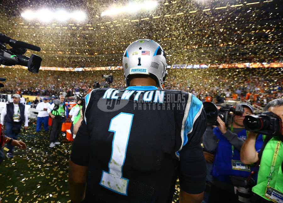 Feb 7, 2016; Santa Clara, CA, USA; Confetti falls as Carolina Panthers quarterback Cam Newton (1) reacts during his walk off the field following the game against the Denver Broncos during Super Bowl 50 at Levi's Stadium. Mandatory Credit: Mark J. Rebilas-USA TODAY Sports