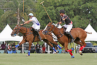 """WELLINGTON, FL - APRIL 25:  Adolfo Cambiaso of Valiente (white jersey) and Juan """"Jota"""" Chavanne head down the field to get control of the ball, as Valiente defeats Orchard Hill 13-12, in OT,  in the US Open Polo Championship Final, to win the U. S. Polo Triple Crown, at the International Polo Club Palm Beach, on April 25, 2017 in Wellington, Florida. (Photo by Liz Lamont/Eclipse Sportswire/Getty Images)"""