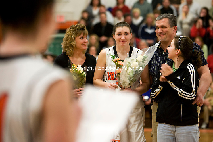 WATERTOWN, CT - 17 FEBRUARY 2009 -021709JT15-<br /> Watertown's Hannah Collier listens to her sister Maggie, foreground, as she honors Hannah on senior night on Tuesday at Watertown, before their game against Wolcott.<br /> Josalee Thrift Republican-American
