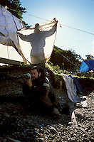 "Student researcher Valeria Bartoli blocks the sun as Oriol Vicente Campos photographs the strata of a shell midden inexcavation by the international team of anthropologists. ""This lifestyle depended on one main thing,"" Piana said, reiterating theneed for fat. ""Any vegetarian here died.""<br />