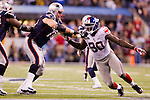 New York Giants defensive lineman Jason Peirre-Paul (90) battles against New England Patriots offensive lineman Chris Snee (76) during the NFL Super Bowl XLVI football game on Sunday, Feb. 5, 2012, in Indianapolis. The Giants won 21-17 (AP Photo/David Stluka)...
