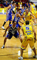 Otago's Brent Charleton looks for support as Troy McLean looks to defend his pass during the NBL Basketball match between Wellington Saints and Otago Nuggets at TSB Bank Arena, Wellington, New Zealand on Sunday, 30 March 2008. Photo: Dave Lintott / lintottphoto.co.nz