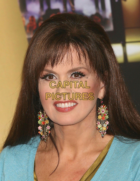 """MARIE OSMOND.The Osmonds attend a photocall to celebrate their No 1 selling DVD """"The Osmonds 50th Anniversary Reunion Concert"""", .London, England, UK, 29th May 2008..portrait headshot earrings red lipstick make-up .CAP/DS.©Dudley Smith/Capital Pictures"""