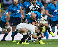 Twickenham, United Kingdom. Down Low Danny CAREwraps his arms round Sergio PARISSE'S, legs during the  6 Nations International Rugby Match, England vs Italy at the RFU Stadium, Twickenham, England, <br /> <br /> Sunday  26/02/2017<br /> <br /> [Mandatory Credit; Peter Spurrier/Intersport-images]