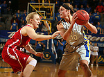 BROOKINGS, SD - FEBRUARY 2:  Kerri Young #10 from South Dakota State looks to pass the ball around Nicole Seekamp #35 from the University of South Dakota in the first half of their game Sunday afternoon at Frost Arena in Brookings. (Photo by Dave Eggen/Inertia)