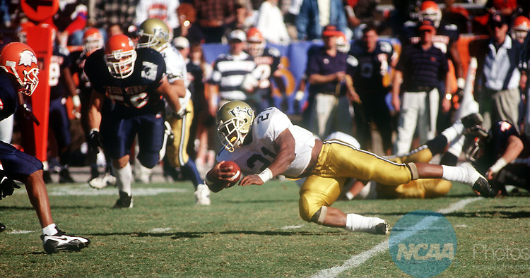 Caption: 14 Dec 1996: University of Northern Colorado tail-back Billy Holmes (21) stretches out to gain a few more yards for his team during the Division 2 Men's Football Championship hosted by the University of North Alabama at Braly Municipal Stadium in Florence, AL... Northern Colorado defeated Carson-Newman 23-14 for the championship title. Josh Gibson/NCAA Photos.