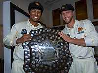 Rachin Ravindra and Fraser Colson. The Wellington Firebirds celebrate winning the 2019-2020 Plunket Shield at Basin Reserve in Wellington, New Zealand on Thursday, 19 March 2020. Photo: Dave Lintott / lintottphoto.co.nz